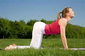 woman doing cow pose